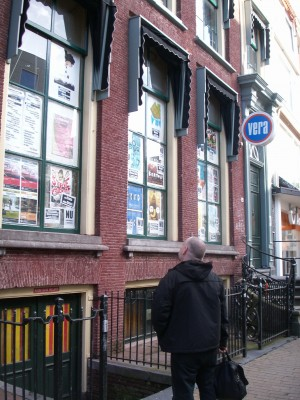 """Bob is amused by the """"ex Crass plays Crass"""" poster at the Vera."""